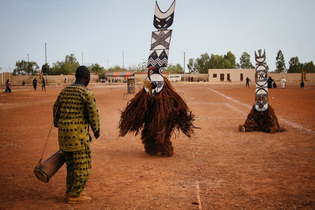 Fiber masks from Boni village (Burkina Faso) perform in the Regional Stadium of Dedougou. Music is essential, played with traditional African nstruments, accompanies very ritual and ceremony.